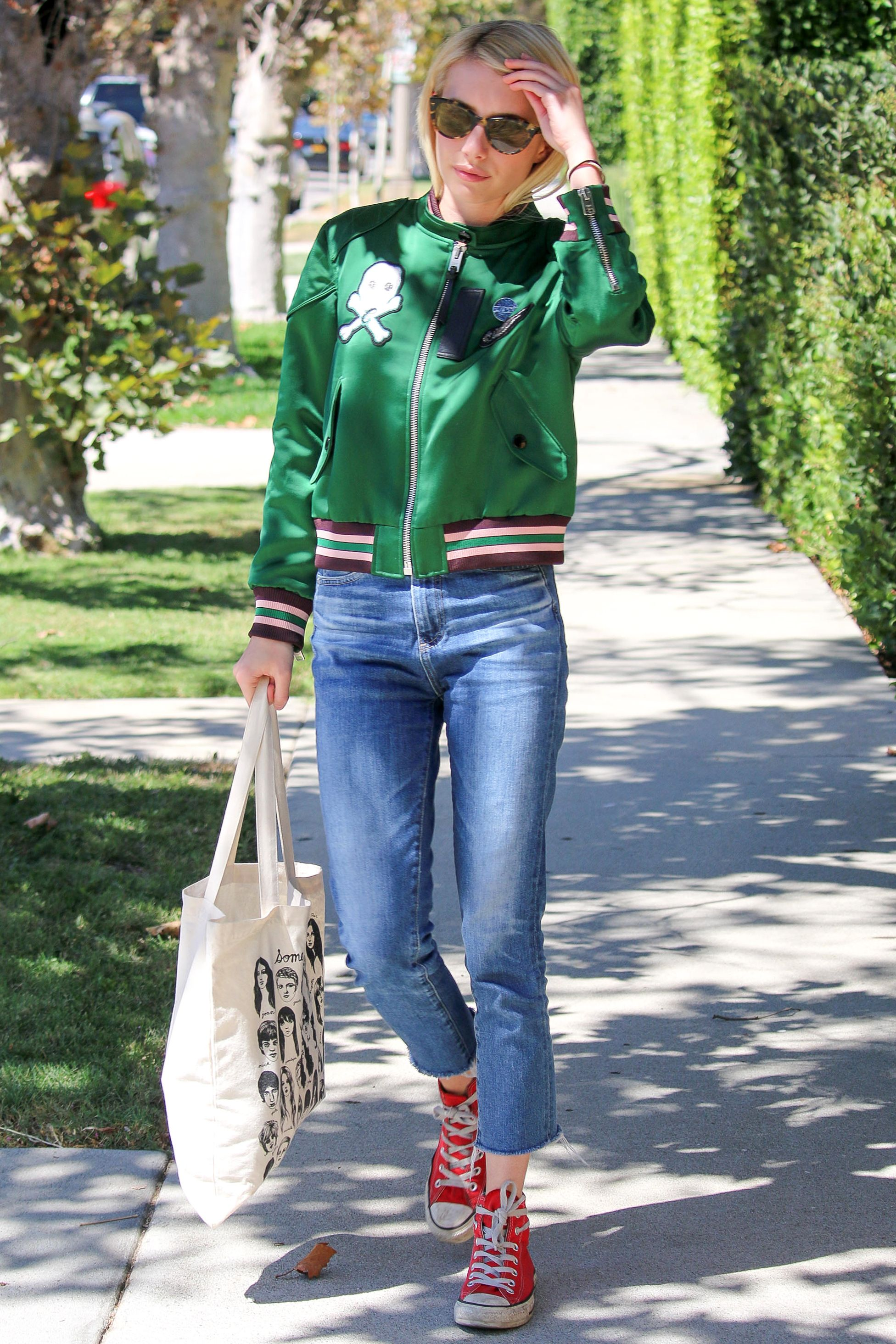514b84ce18c73c These 19 Celebrities Are Obsessed with Wearing Converse - Emma Roberts from  InStyle.com