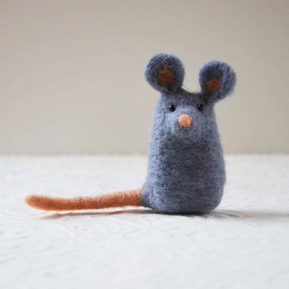 Mousekitts (photos #1 + #3) has been needle felted, a time consuming process in which wool roving is poked repeatedly with a barbed needle until the desired shape is formed. He stands 3 inches tall, just the right size to fit in your pocket! He is only made out of wool and has two #needlefeltedanimals