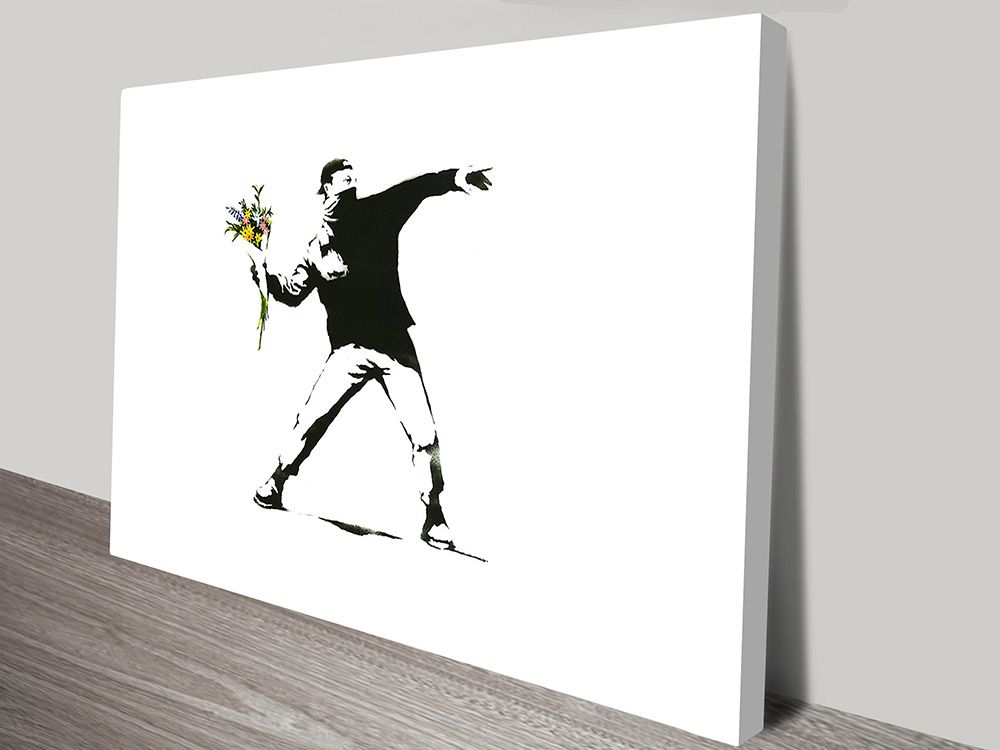 This is a print of one of the most famous Banksy street art designs, the graffiti design is often called 'Rage' Flower Thrower or 'Love is in the air'.
