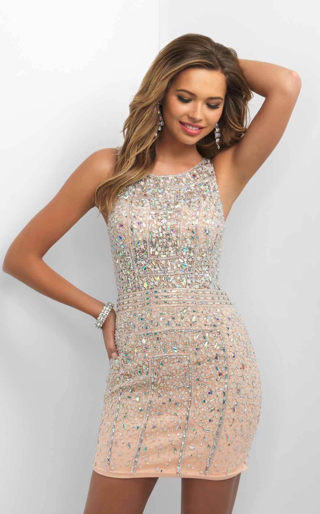 Shine on wearing this blush c cocktail dress this sleeveless