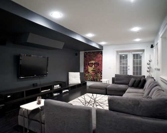 Media Room This Media Room Is Great For The Monochromatic Color Scheme And The Splash Of Color Added Home Theater Rooms Media Room Seating Media Room Design