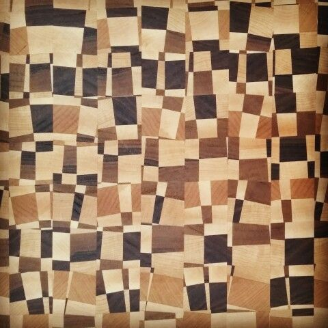 End grain cutting board with walnut maple and cherry.
