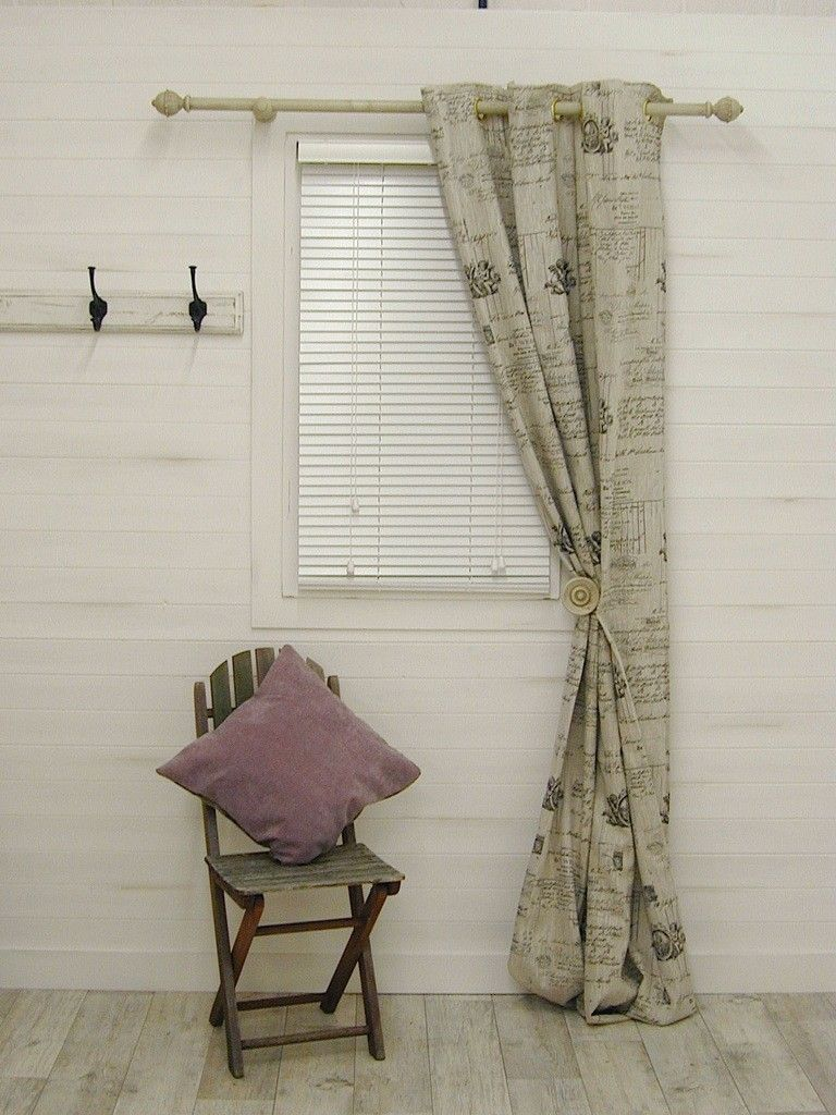 curtains with black script writing bay window