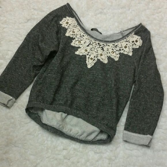 20% OFF BUNDLES! Lace Crop Sweater Has a wide neck and can be worn on one shoulder and shorter like a crop top. Tag says Large, but seems like a medium. Tops Crop Tops