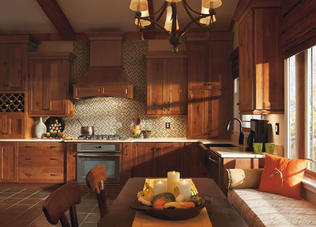 The Warmth Of Homecrest S Dover Cabinets In Terrain Finished Rustic Hickory Provides Rustic Kitchen Cabinets Kitchen Cabinetry Design Hickory Kitchen Cabinets