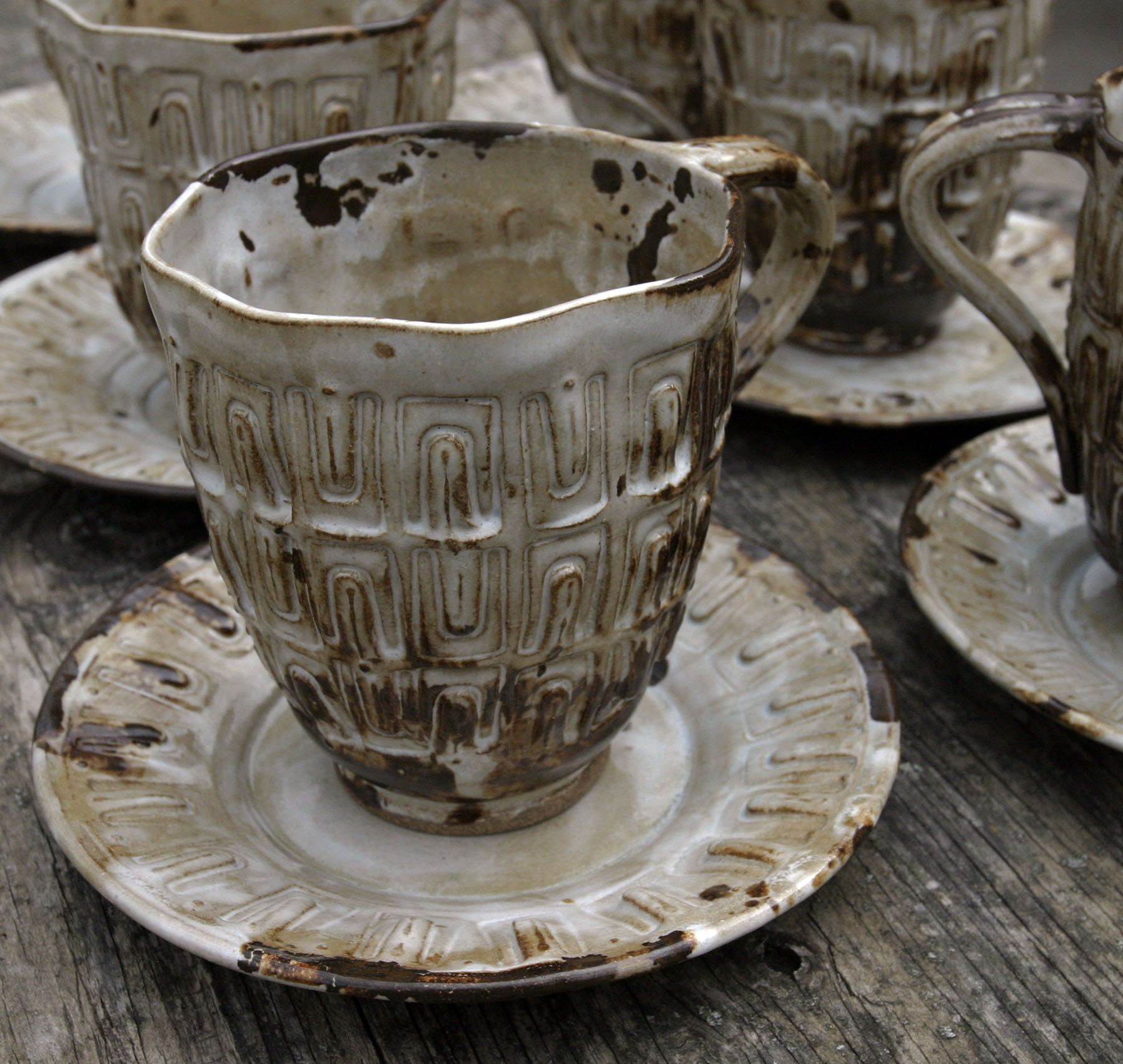 Industrial Rustic Cups and Saucers.  Mark Strayer, North Star Pottery