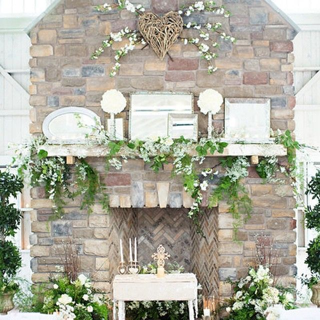 Even during the summer months, this chapel's fireplace sets an intimate scene! Double tap if you agree. #weddingideas #shabbychic {Photo: JOHNARCARA PHOTOGRAPHY}