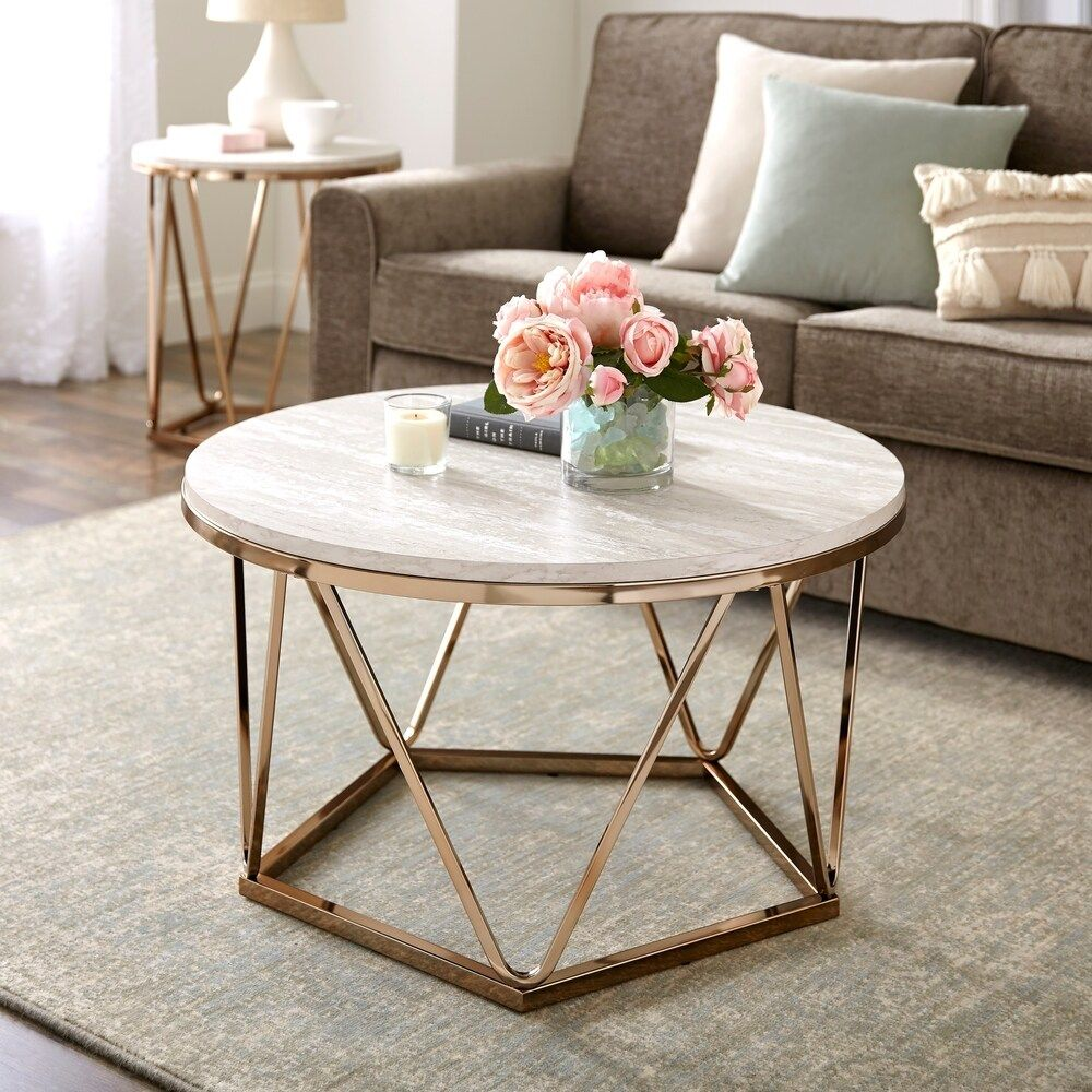 Find your style angle with this modern, round coffee table in your living room or den. This coffee table has a champagne and faux travertine finish that provides a glamorous and modern style. The spacious tabletop and geometric metal base provides a unique and appealing look. Features Made of 15 mm particle board and paper veneers Natural cocktail table Cocktail table w/ faux stone top Spacious tabletop Geometric goldtone metal base Simulated stone appearance will vary Glam to modern style Champ