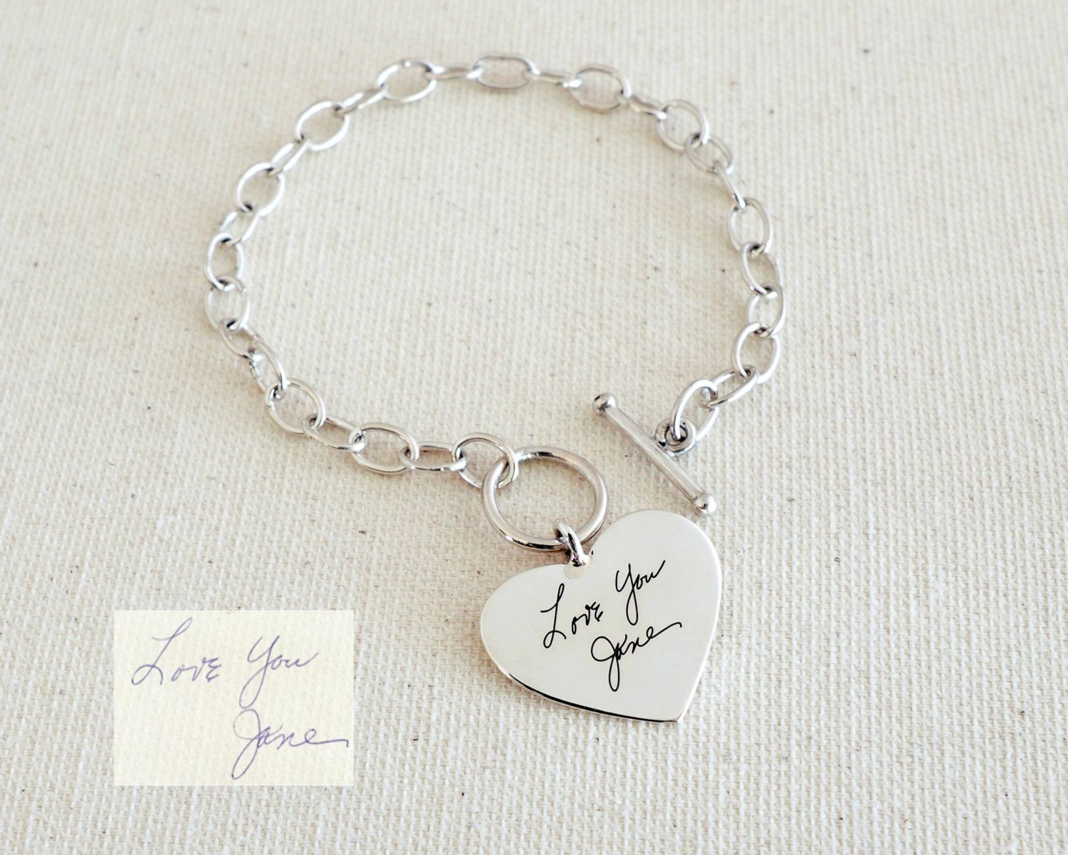 ♥ NEW DESIGN: Engraved Handwriting Bracelet with Heart charm. ♥ Simply use the -ASK A QUESTION- or -CONTACT SHOP OWNER- button to send us a picture or scan of the Signature//Handwriting//Message before or after purchasing. ♥ Messages can be engraved on two sizes of the charm with an additional fee - $8  • If you want engraving on one side of the bar, choose ONE SIDED*. If you want engraving on both sides, choose DOUBLE SIDED*. Feel free to email us for details…