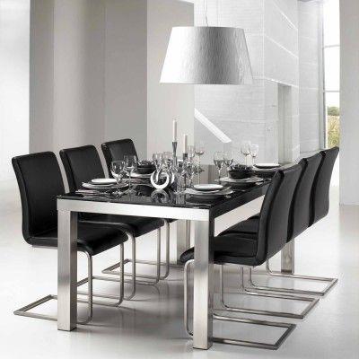 Flot spisebord med kraftige metal ben i chrom og en solid glasplade ...