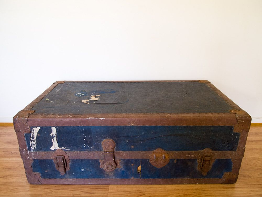 vintage navy blue shipping trunk/coffee table by epochco on Etsy - love the navy blue on this one!
