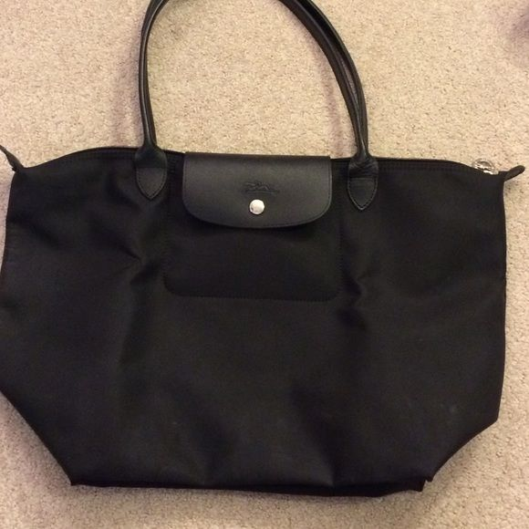 695192d74e Longchamp black tote Just large enough for a laptop or notebook. Made of  Thick and tough material. Longchamp Bags Totes