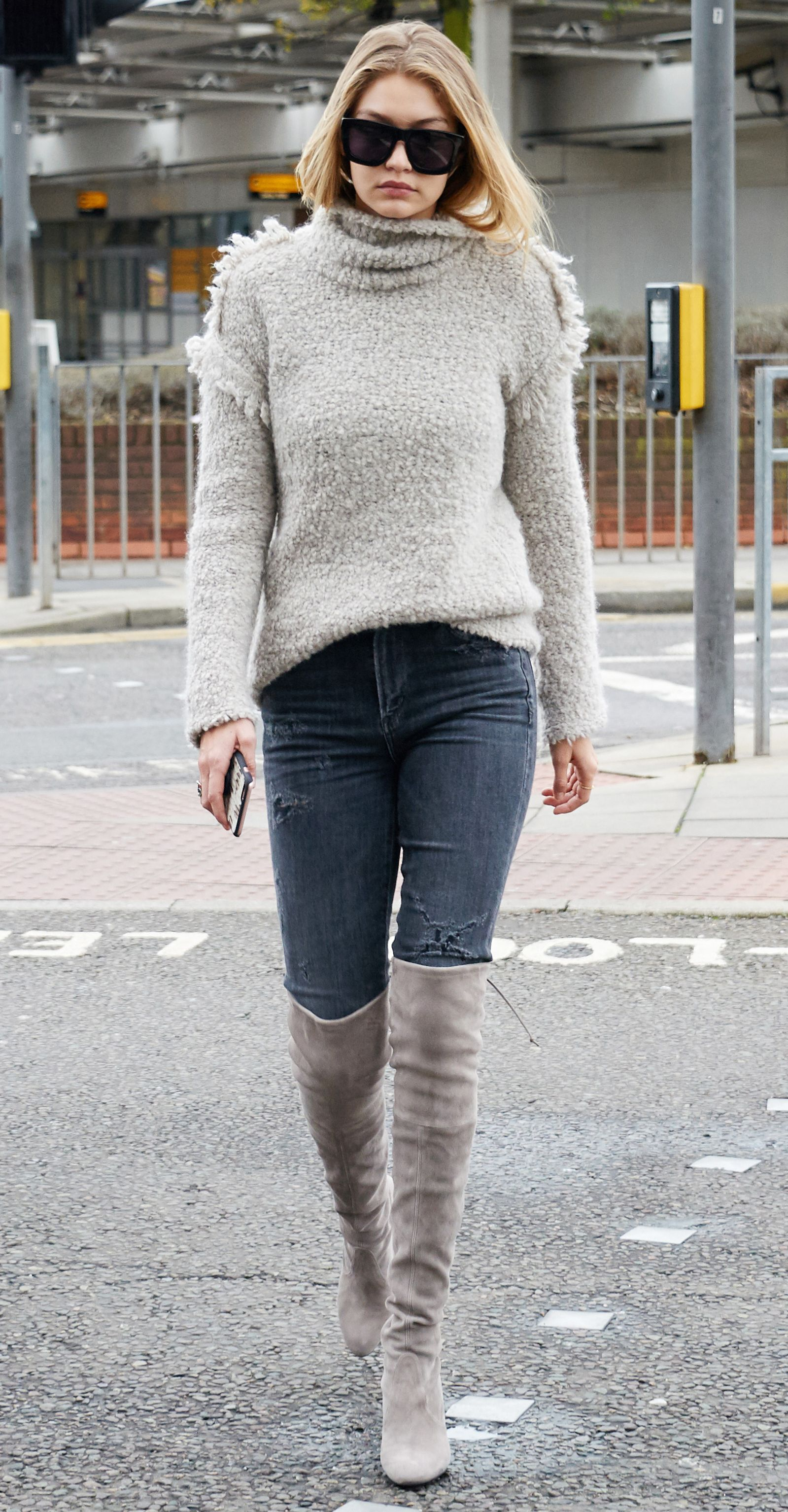 7ce2162b503 Gigi Hadid in a cozy gray fringed turtleneck