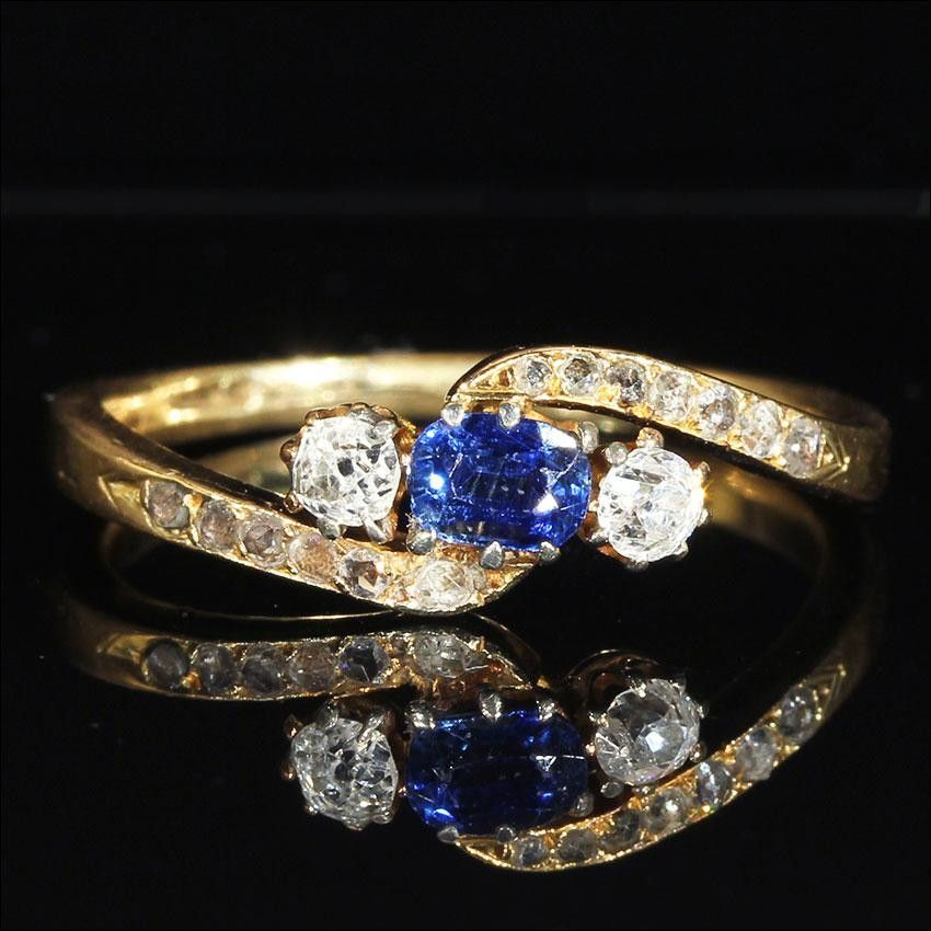 Antique toi et moi bypass ring with sapphire and