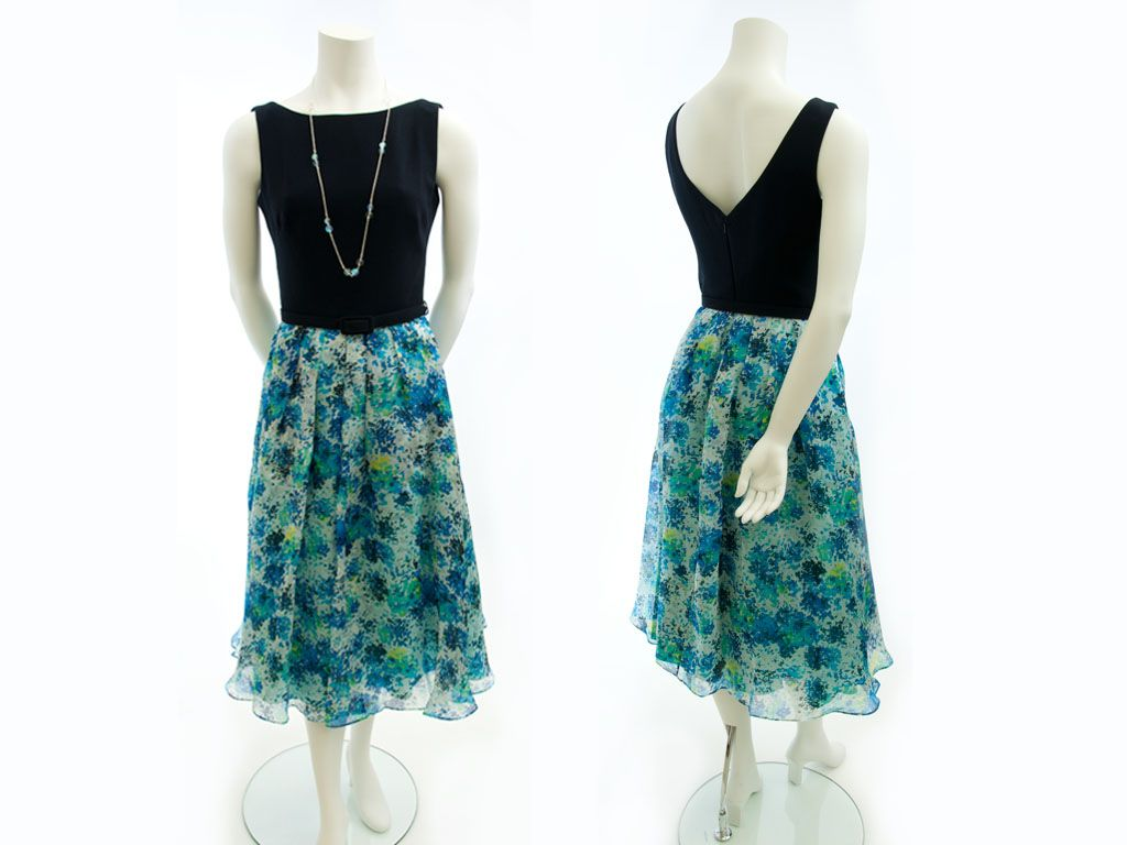 """9.1 BUYERS NOTES """"A flattering silhouette for many different body types - mixing two different fabric weights balances out proportions""""   THEIA - tea length dress w/black crepe bodice and blue floral print silk skirt, dry clean - 0051230 $795  CARA COTTER - silver chain 36"""" necklace w/prism Quartz beads - 0104010 $315 Contact BLU'S at shop@blus.com to order"""