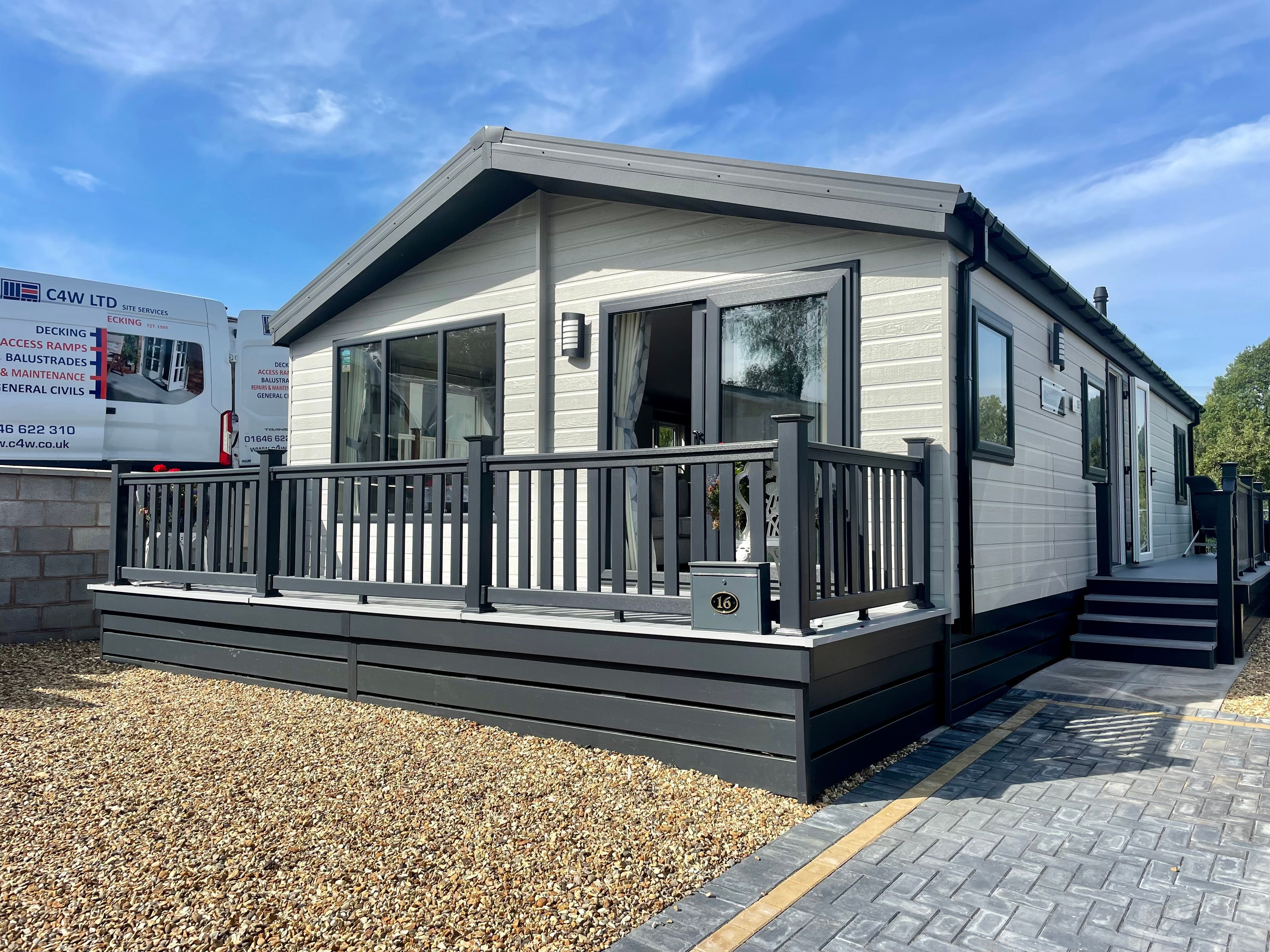 Lodge front enclosed deck with separate side deck and clear glass balustrade for taking advantage of this lovely view