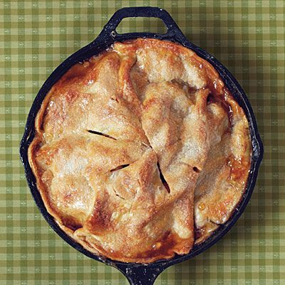 Easy Skillet Apple Pie | No rolling pin required for this easy apple pie! Refrigerated piecrusts make it a cinch to prepare. Enjoy the buttery, rich layer of caramelized brown sugar beneath the crust. | SouthernLiving.com