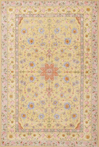 A silk and wool Tabriz rug signed by Shahsavarpoor Northwest Persia size approximately 4ft. 6in. x 6ft. 9in.