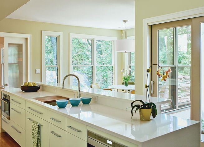 A Gessi faucet, paired with a Kohler sink, contributes to the clean, modern look of this renovated New Jersey kitchen. Photo by: Brian W. Ferry