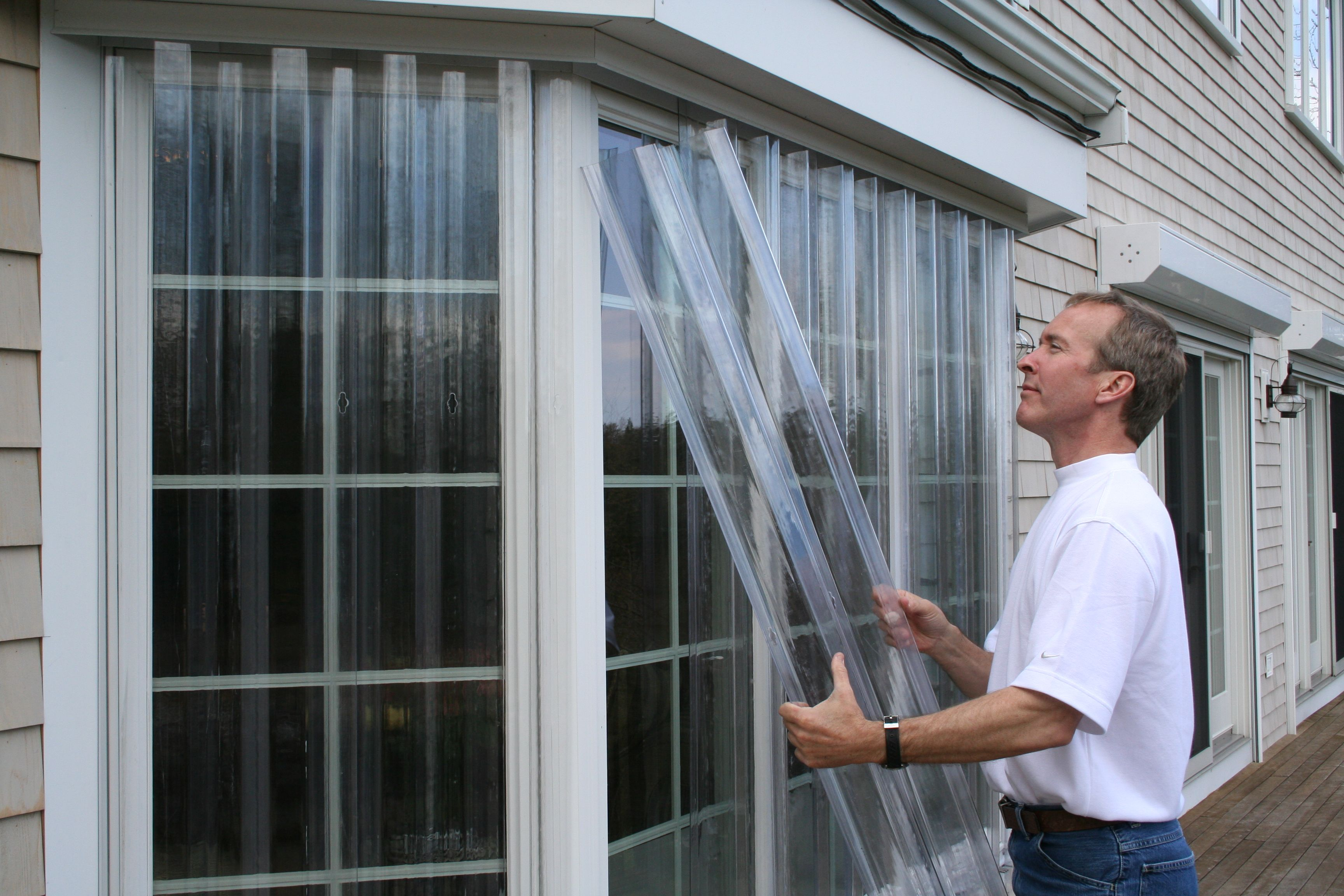 Installing Vusafe Storm Panels Over Bay Windows These Hurricane Protection Panels S Hurricane Window Protection Hurricane Shutters Shutters Exterior
