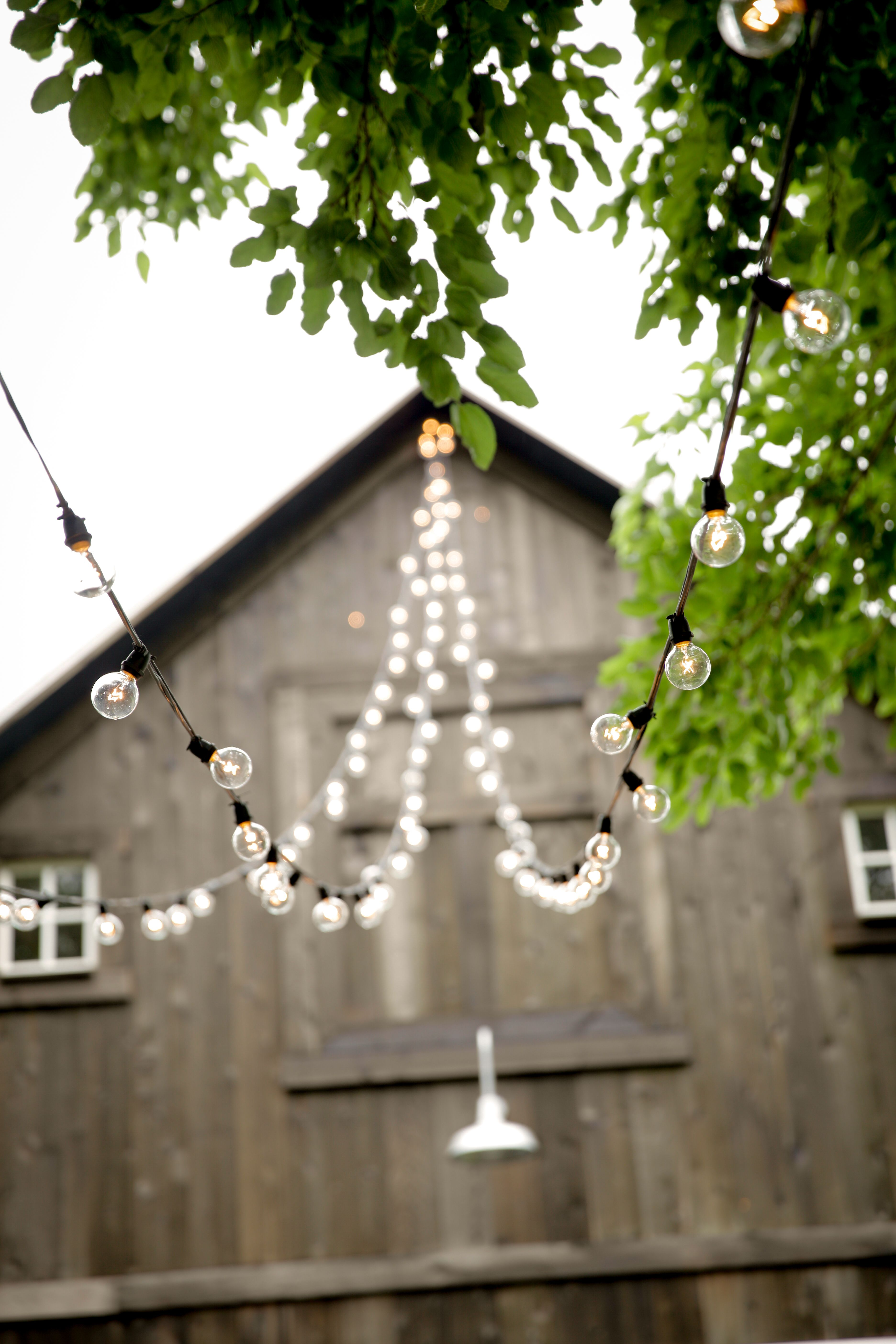 Lights Strung On An Indiana Wedding Barn