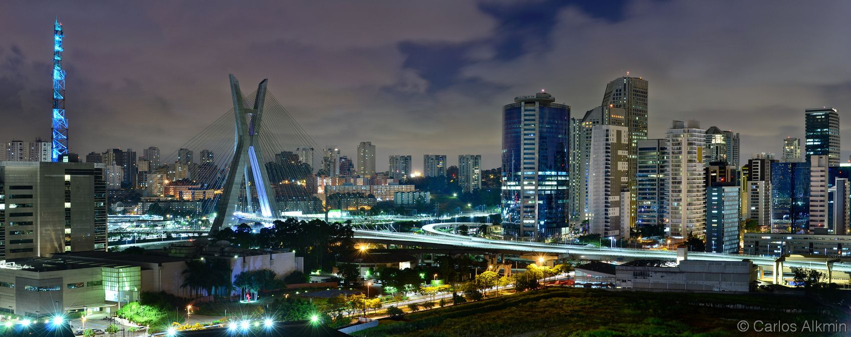 """To purchase prints and license, please contact me: carlos.alk@uol.com.br. Description: Sao Paulo iconic skyline with cable-stayed bridge - Skyline of the modern part of Sao Paulo, Brazil - on the left side, Globo TV Sao Paulo headquarters and """"Octavio Frias de Oliveira"""" cable-stayed bridge - night view. On the right side, some of the modern corporate buildings at Berrini avenue region / Brooklin Novo district.  All rights reserved © 2016 www.CarlosAlkmin.com.br"""