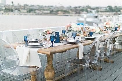 At a nautical wedding - a wood table with ghost chairs - everything doesn't have to match! ~ 100 Layer Cake