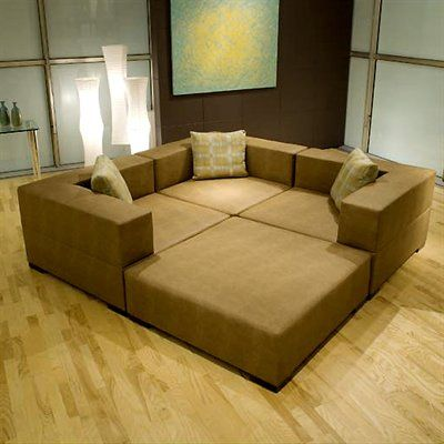 Fat ed sectional converts from a giant couch to four for Sectional sofa that converts to bed