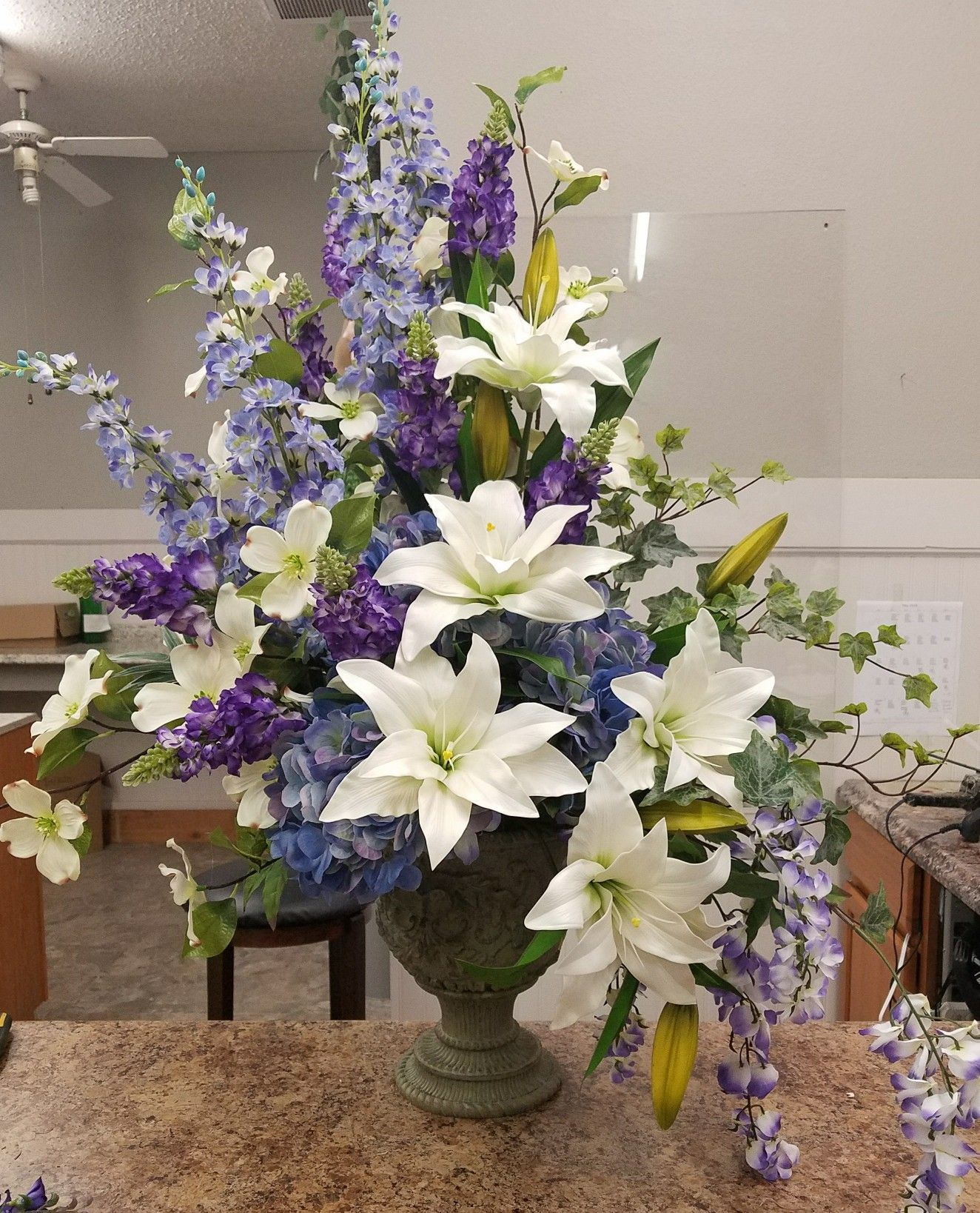 Summer Church Arrangement Filled With Blue Delphinium And