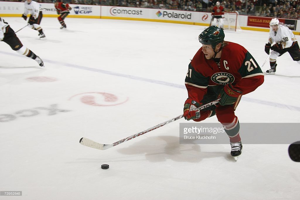 Mark Parrish 21 Of The Minnesota Wild Skates With The Puck Against