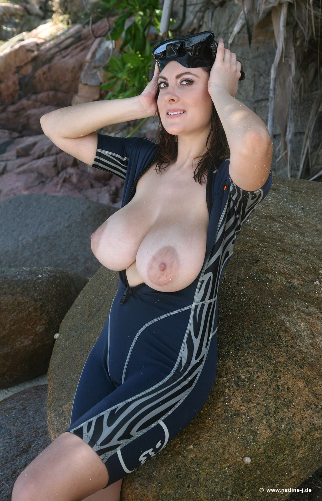 major wardrobe malfunction! wetsuit bursting open, revealing huge