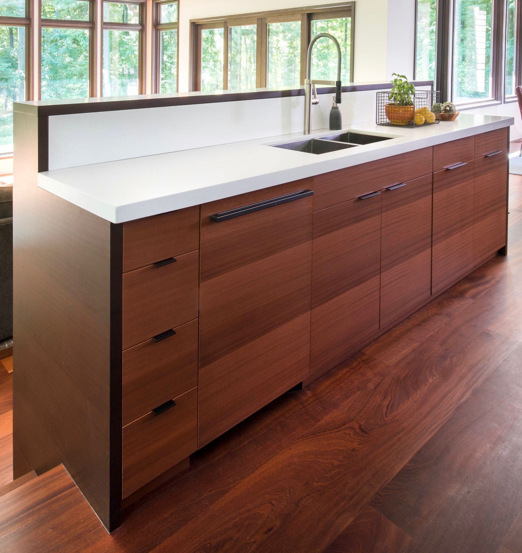 These sapele wood cabinets blend seamlessly with the ...