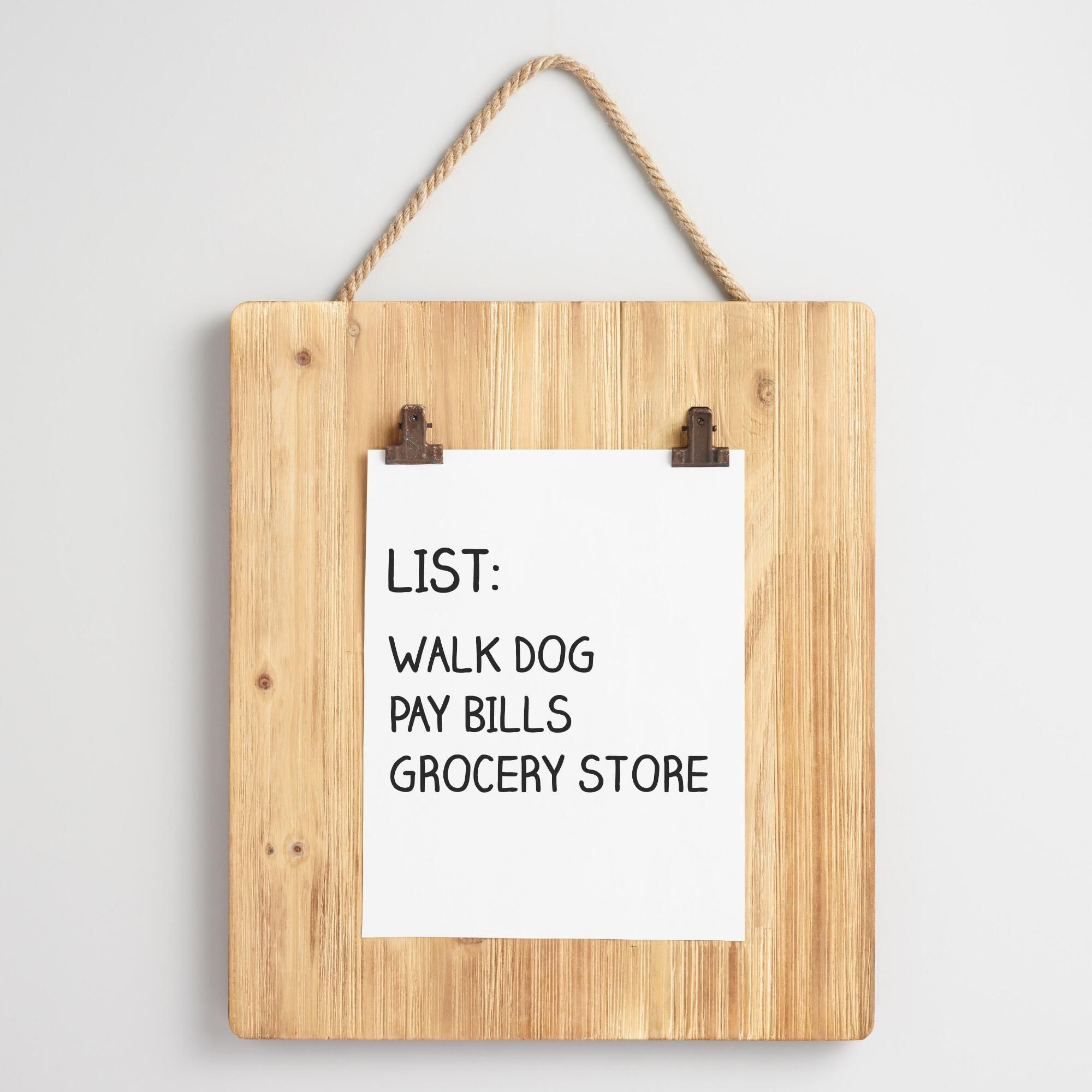 Hanging from a jute rope, our clipboard wall decor offers a charming ...