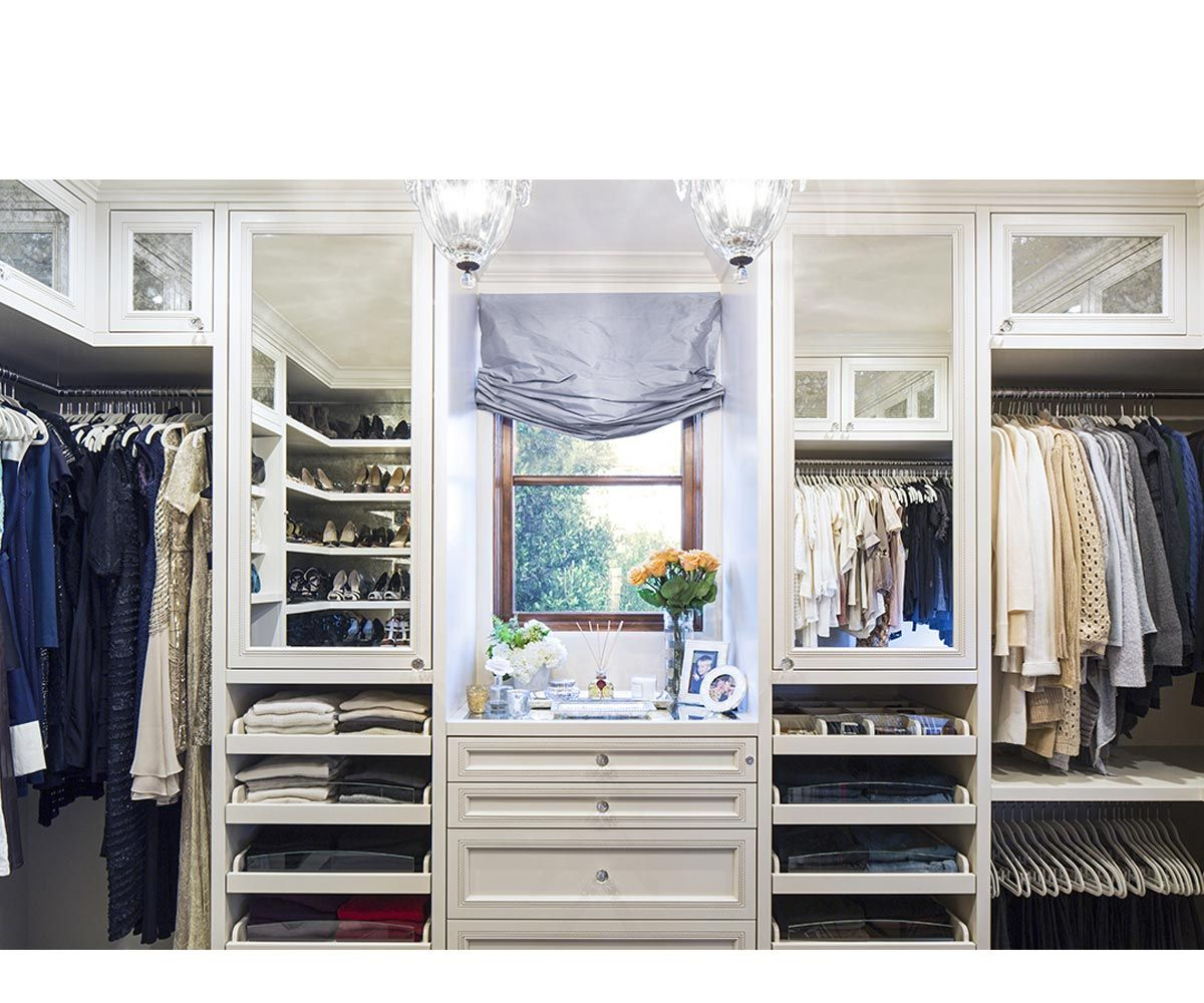 Large Walk In Closet With Pull Out Drawers Multiple Tiers Of Hanging Space And A Small Window To Let In N Walk In Closet Design Closet Remodel Closet Designs
