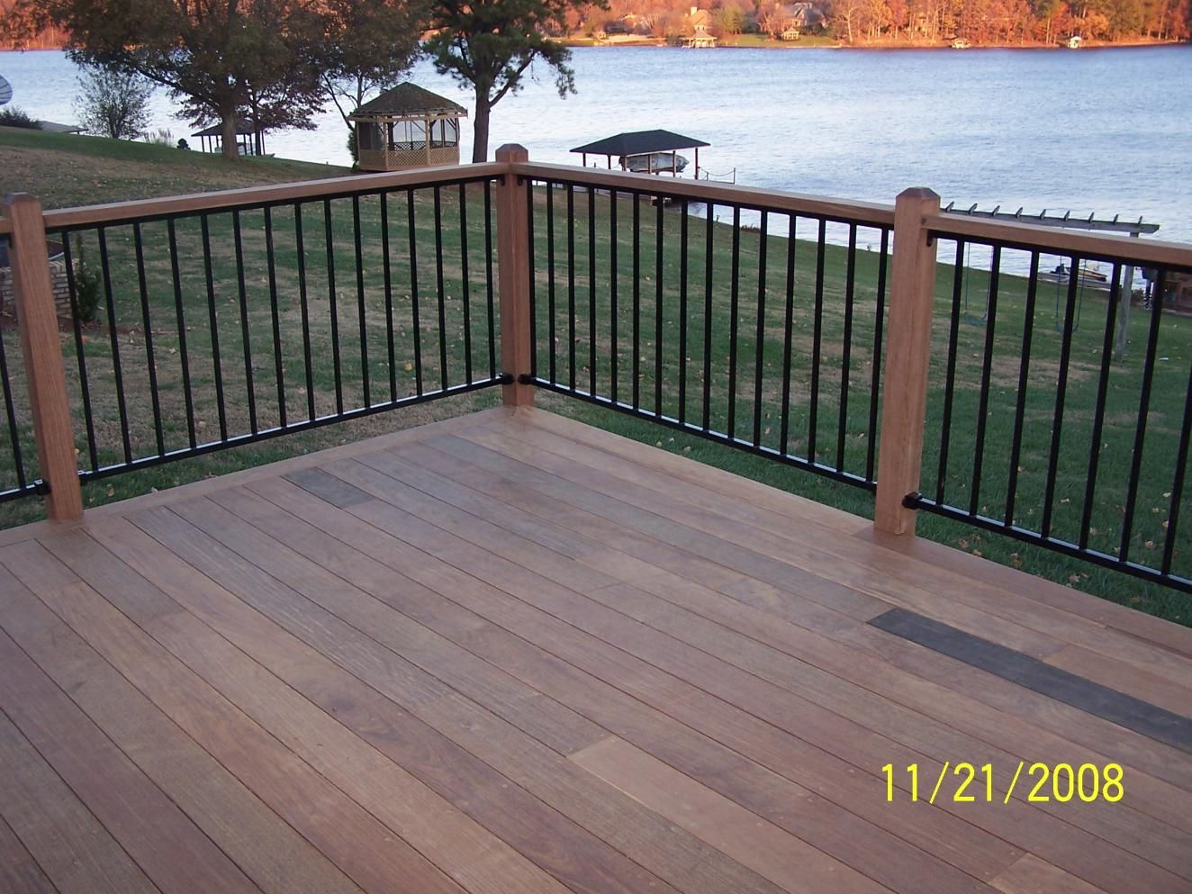 Charming Brown Wooden Deck In Trex Decking Cost Matched With Black Railing For Patio Decor Ideas