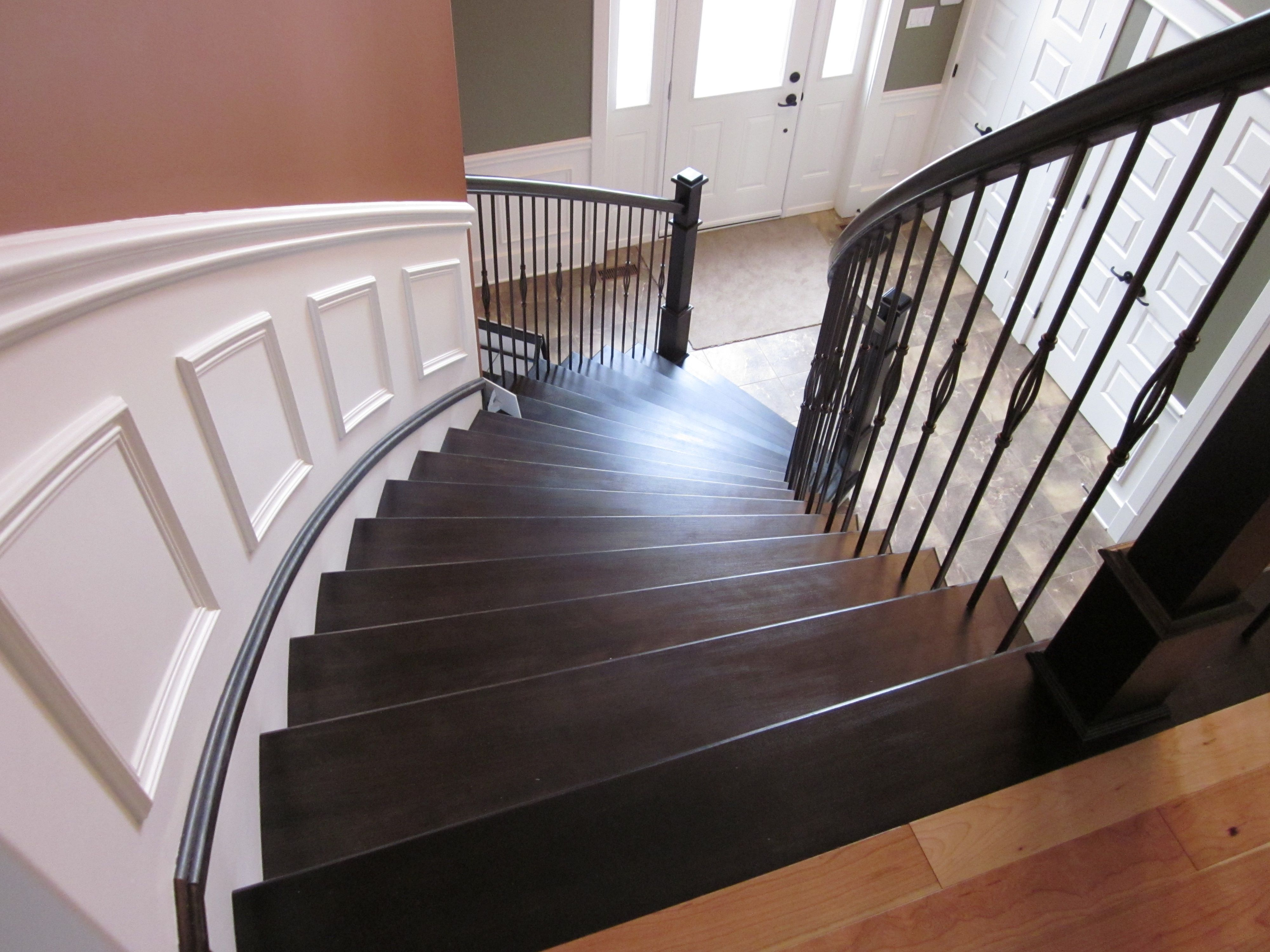 Curved Staircase With Painchaud Newels And Decorative Metal Balusters