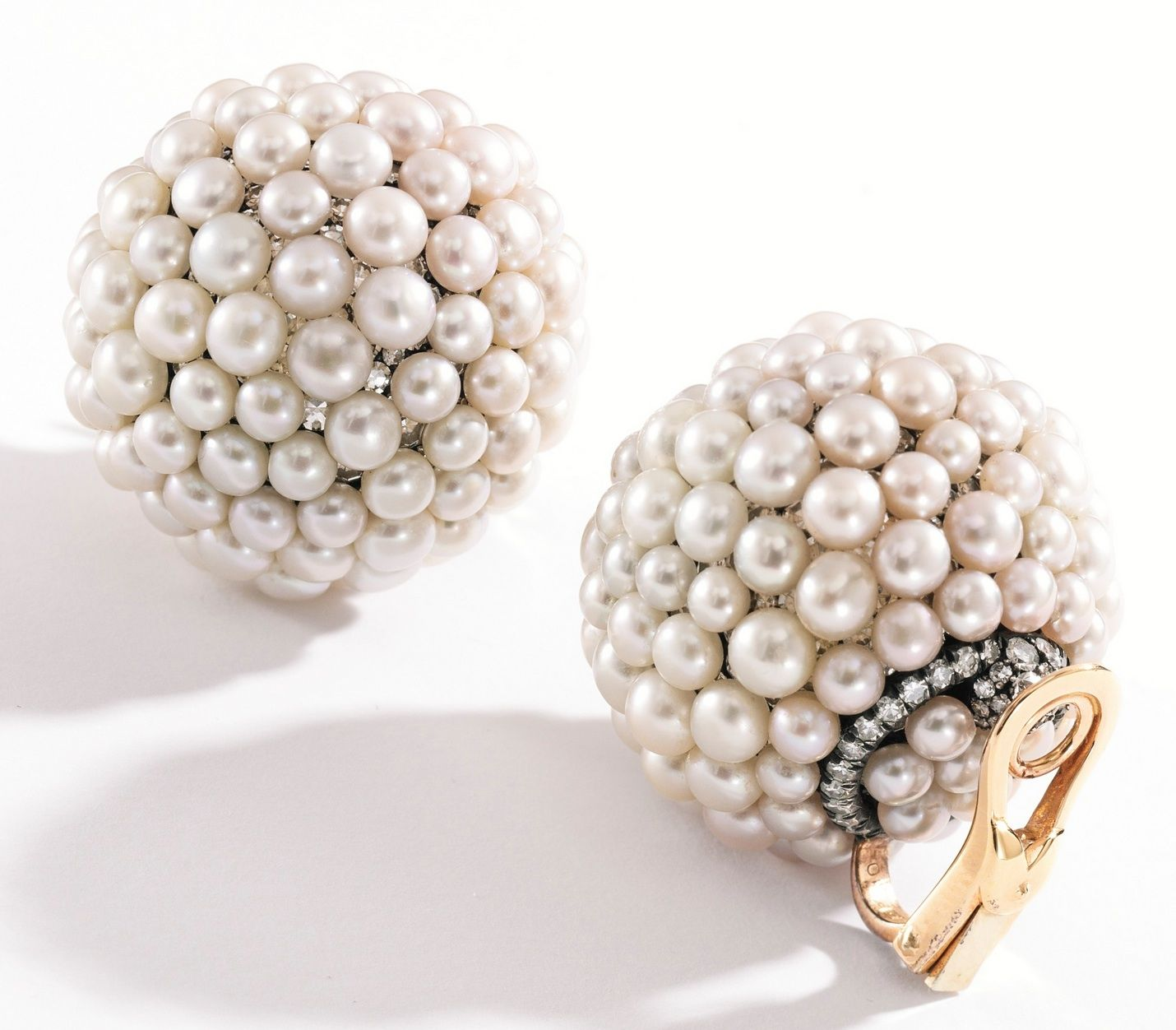 How fun! Spherical clip earrings covered in button-shaped pearls with single cut diamonds nestled in between. To go up at auction this month in Sotheby's Magnificent Jewels auction, estimated to go for $30,000-$50,000.