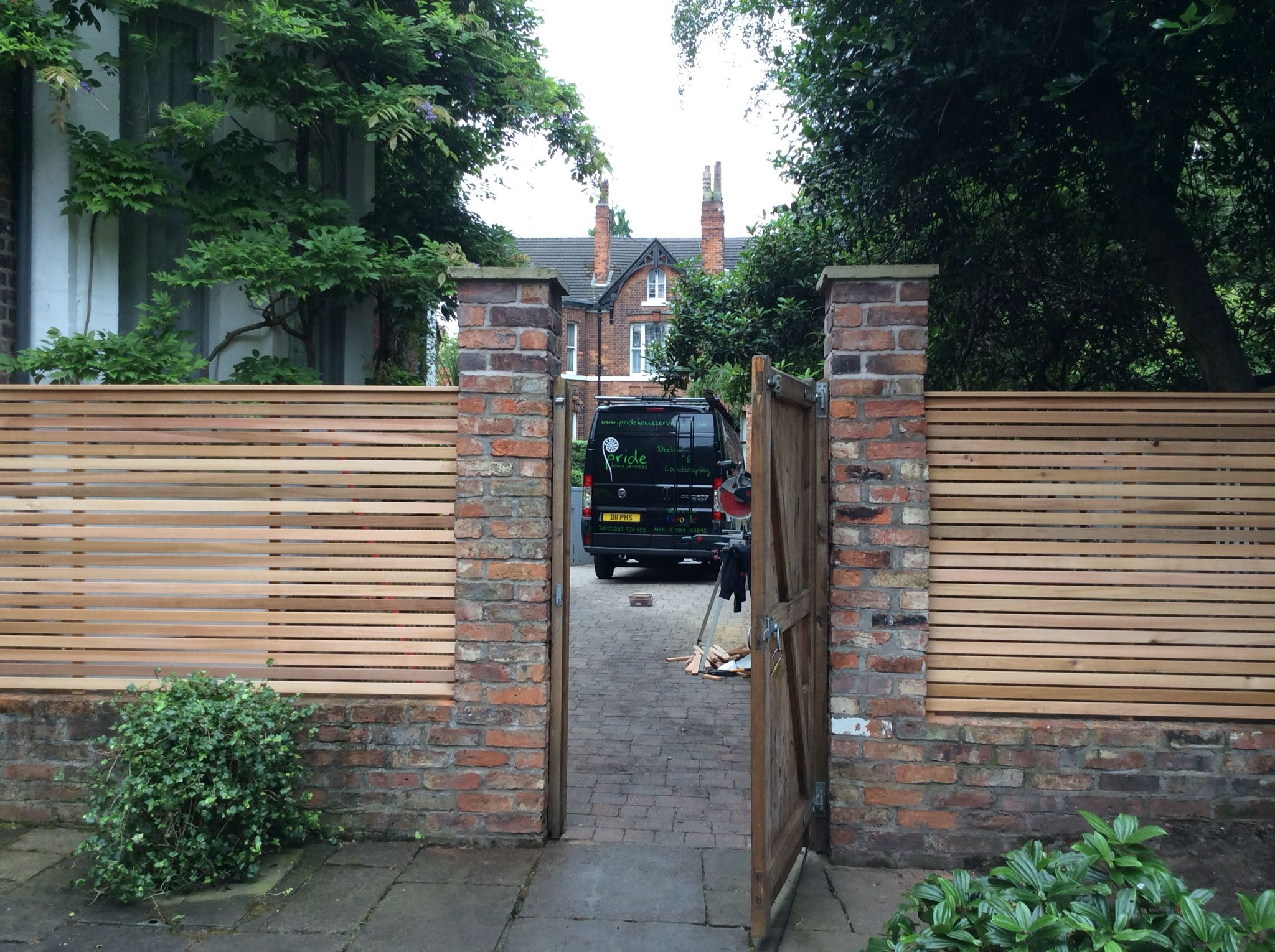 Cedar Fencing Between Brick Pillars