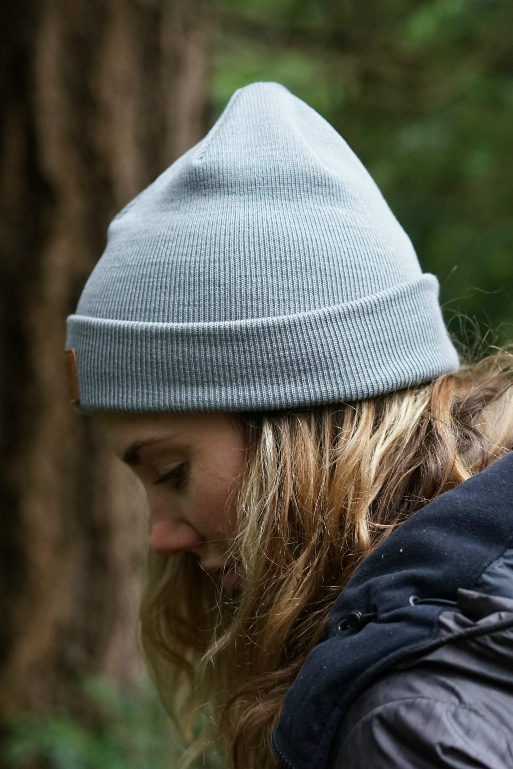 e6046f16bb82f Hipster hiking outfit with a grey wool beanie for Women. Ethical and  ecological sustainable merino wool beanie by VAI-KO. Photo and model   secretagentmike ...