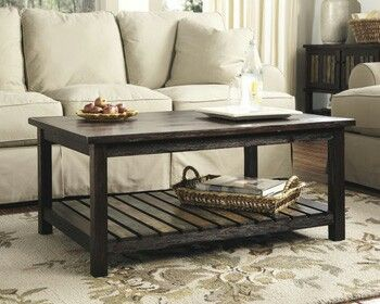"Ashley Mestler Rectangular Cocktail Table. Dimensions:	42""W x 28""D x 18""H Available at Foothills Family Furniture"