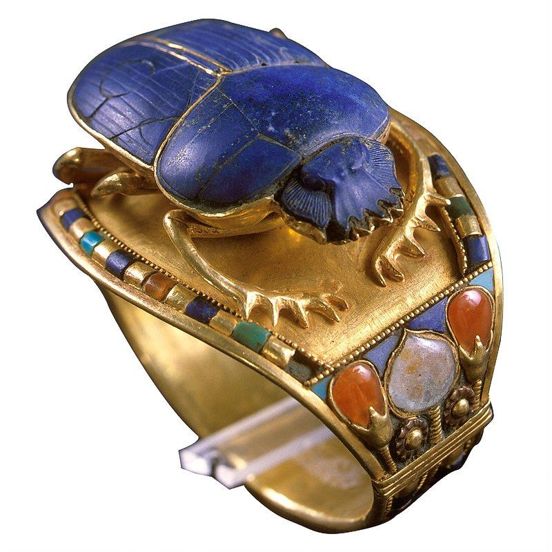 Egyptian Museum - Bracelet of Tutankhamun with Scarab  UPPER EGYPT: GOVERNORATE OF LUXOR: THEBES: WEST BANK: VALLEY OF THE KINGS   NON ORGANIC: MINERAL: LAPIS LAZULI   NON ORGANIC: MINERAL: CARNELIAN   NON ORGANIC: METAL: GOLD
