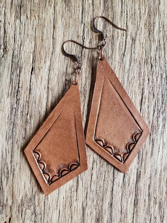 Photo of Leather earrings with sunburst pattern, southwestern, hand tooled leather earrin…