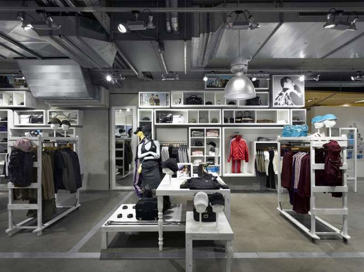 cf598c04c00 Adidas concept store - Berlin. Nice use of a single colour to unite  miscellaneous furniture elements.