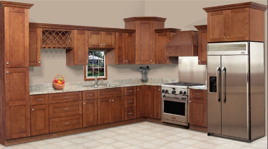 Sienna Shaker Kitchen Cabinets by RTA Cabinet Store Medium color wood, light countertops