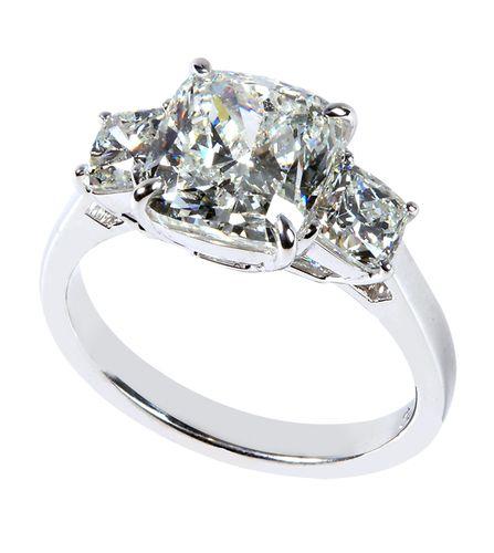 #Platinum and #Diamond ring by Rahaminov, with a 3.01 cushion diamond, flanked by two cushion shaped diamonds. Available at TIVOL.