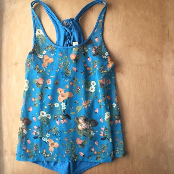 Princess Vera Wang Floral Tank Top Worn maybe once or twice. The fabric on the front is kind of see through, that back solid and has a really cute tie. When taking pictures I noticed a tiny spot on the front on the bottom that might be a stain but it could just be a part of the floral design, unless your really inspecting like I was its unnoticeable Princess Vera Wang Tops
