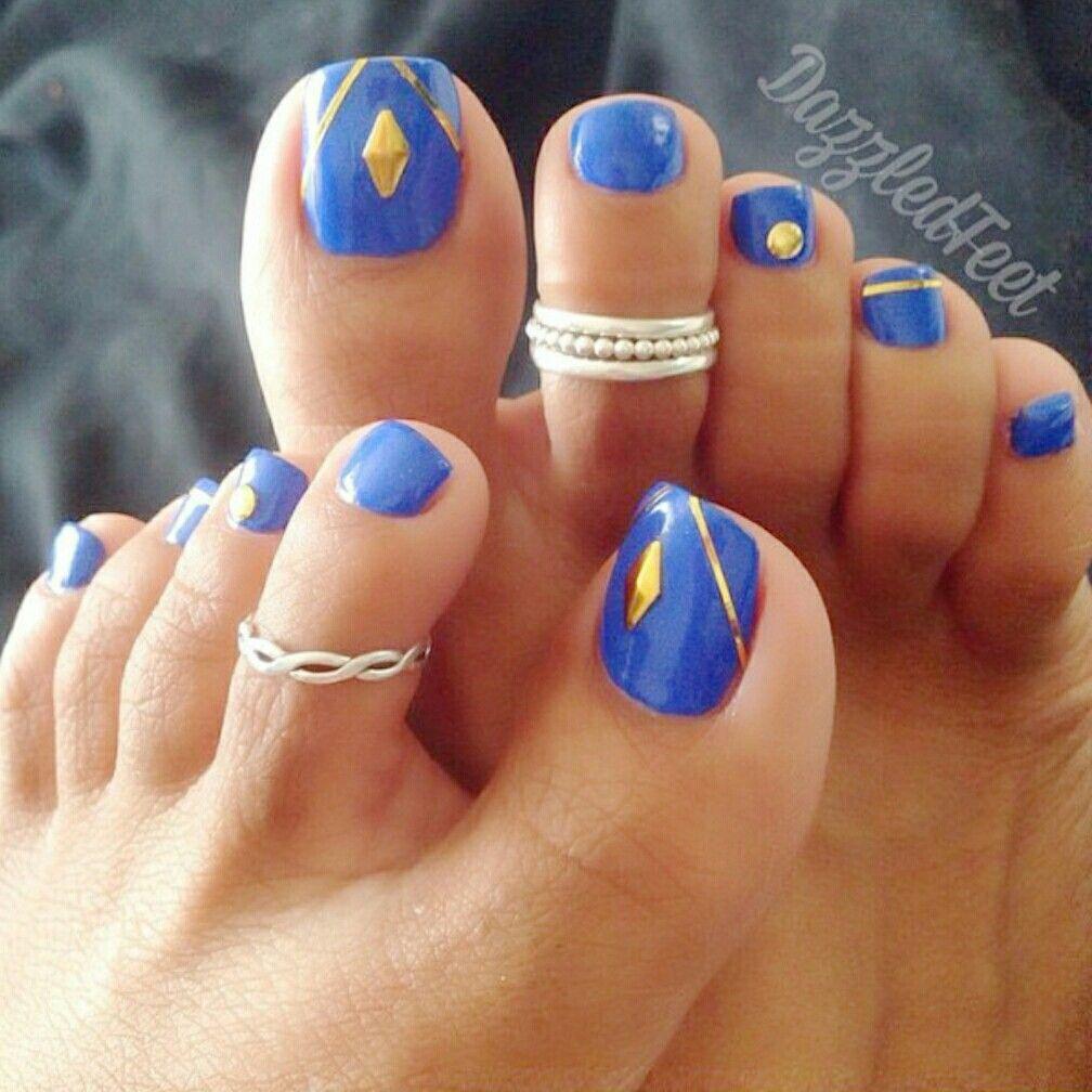Royal blue & gold pedicure w silver toe rings...exotic vibe ...
