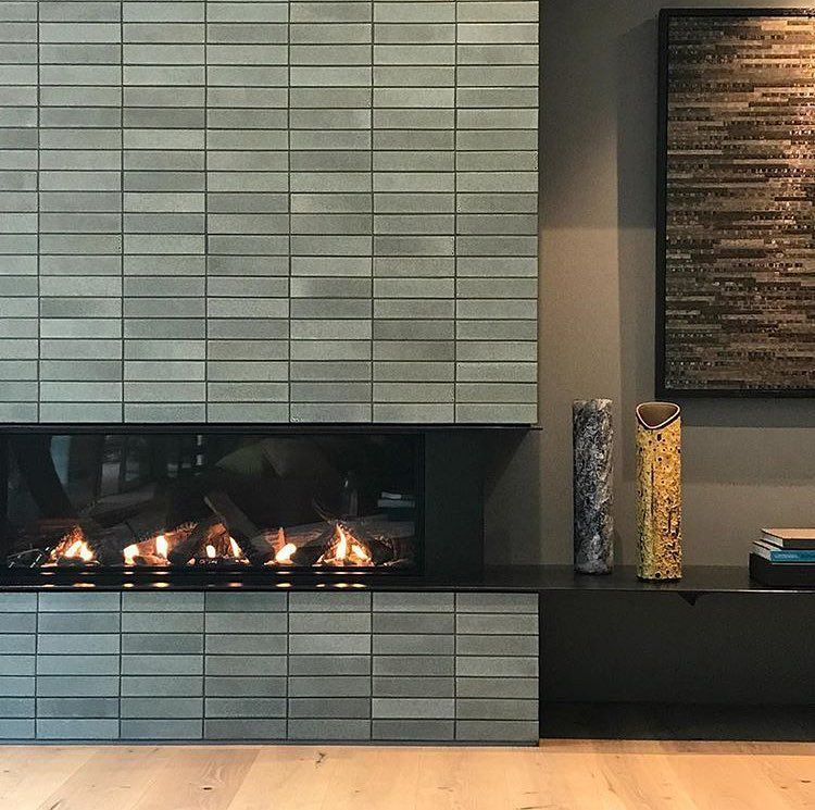 Heath Ceramics S Tile Feed On Instagram The Perfect Fireplace To Cozy Up To As You Wrap Up In 2020 Fireplace Tile Heath Ceramics Tile Fireplace