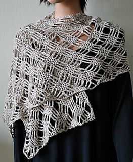 This silky, lace stole works up quickly in Panda Pearl. It is very soft and has beautiful drape. The project features a web-like lattice design that is repeated over 8 rows.