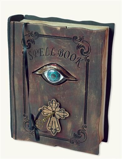 Mere touch will send this haunted spellbook into a terrifying tremble. Jeweled eye and keyhole flash with eerie blue-green light, accompanied by bloodcurdling sounds from within the book.